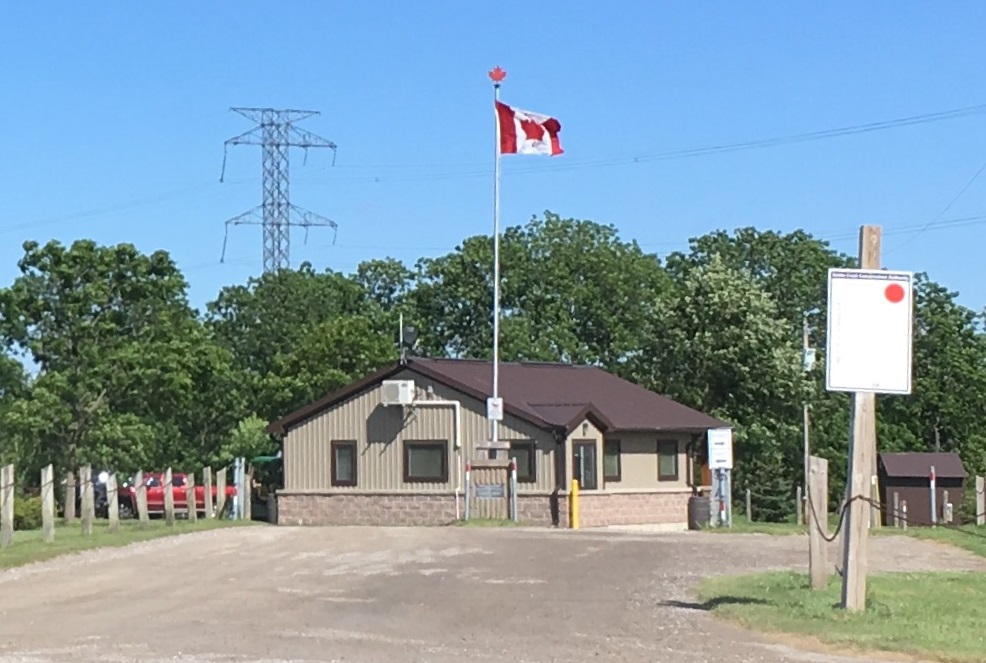 the gatehouse at Dalewood Conservation Area flying Canadian flag