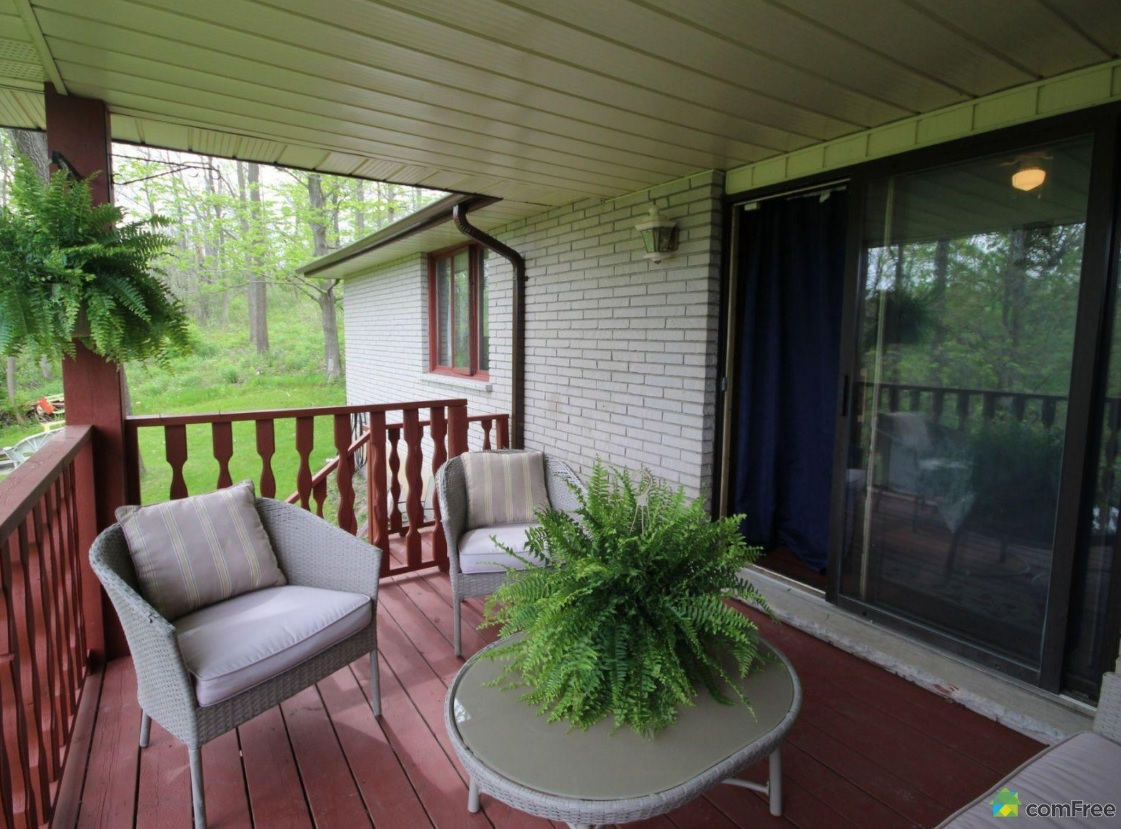 Shady deck off bedroom at 42815 Beck Line, St Thomas