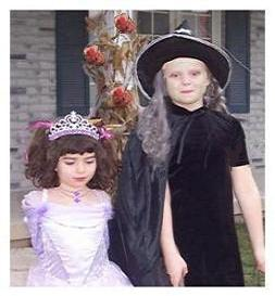 children at halloween a princess and a witch