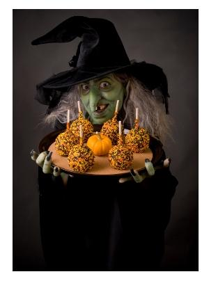 Halloween witch with candy apples