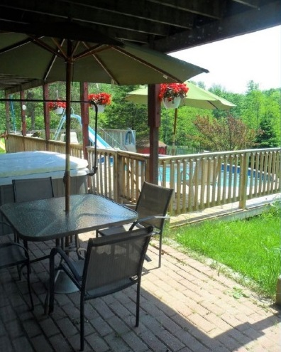 lower patio and pool area at 42815 Beck Line, St Thomas, Ontario