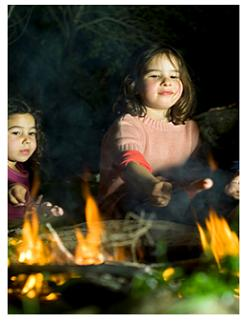 Children around the campfire Dalewood Conservation Area, St Thomas