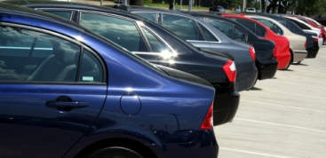 car rental vehicles waiting for drivers in parking area