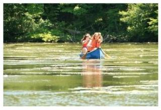Family canoeing at Springwater Conservation Area