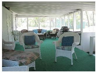 The screened-in porch at the cottage at Crystal Beach, Ontario