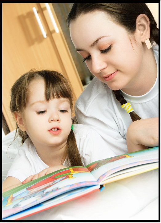 homeschooling mother and daughter reading together