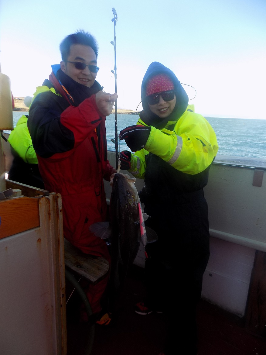 two tourists catching cod, Iceland, whale watching boat trip 2017