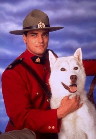 Paul Gross as Mountie Benton Fraser with dog Diefenbaker
