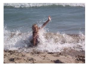 Small blonde child being splashed by waves, Lake Erie, Port Stanley, Ontario, 2005