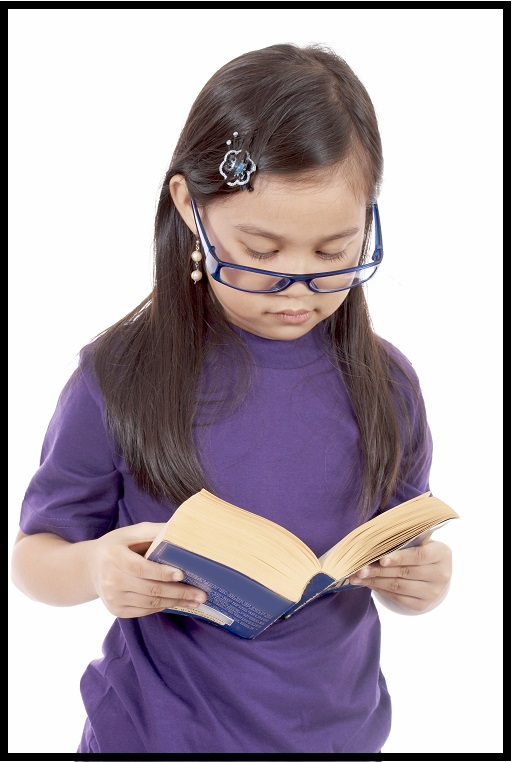 homeschooled girl in purple dress with a book wearing glasses