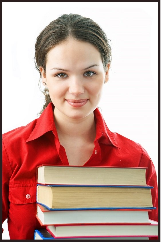 homeschooled teen in red shirt smiling with books