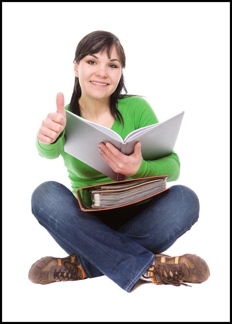 happy homeschooling teen in green shirt gives thumbs up