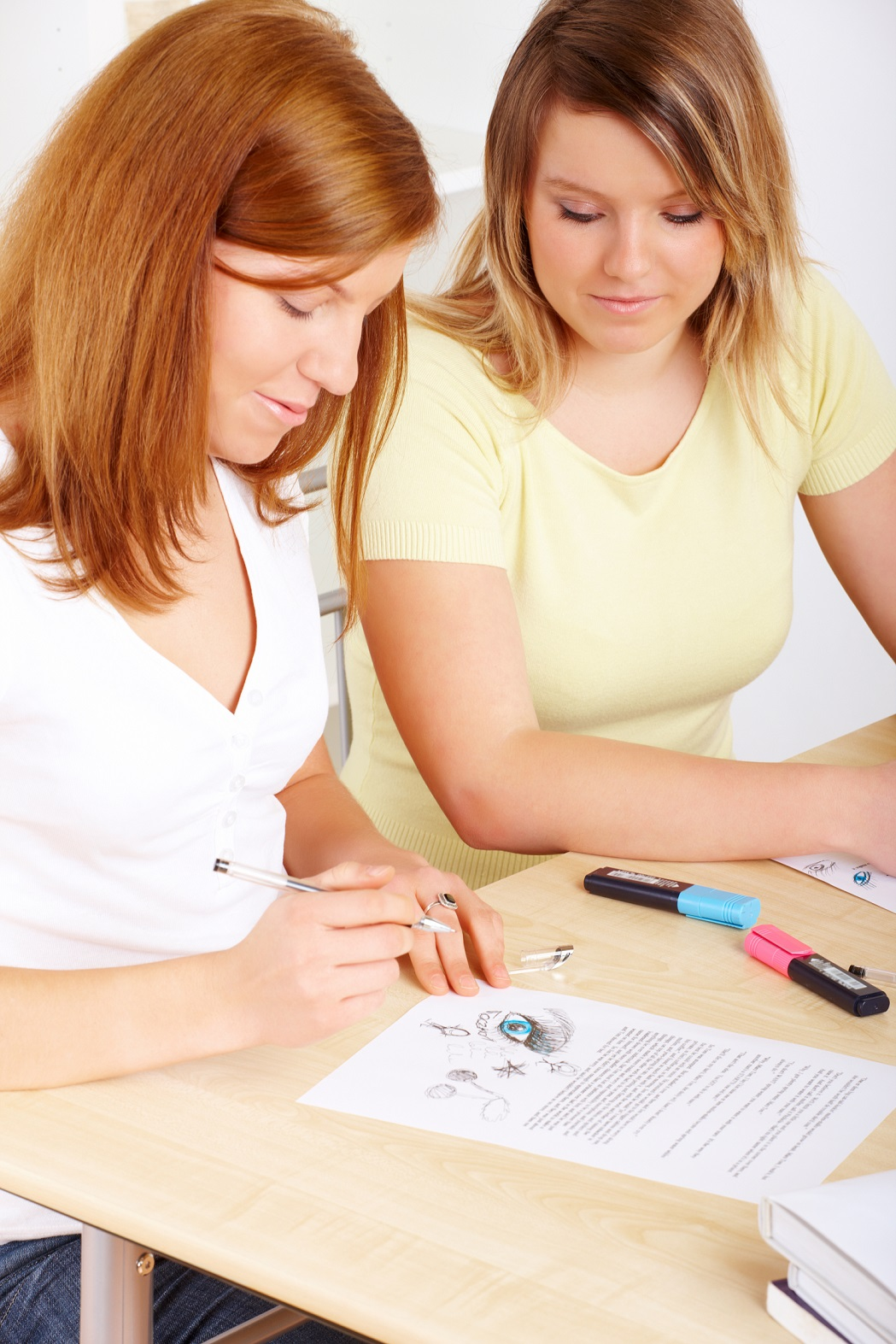 girl in white learning at home homeschooling with her mother